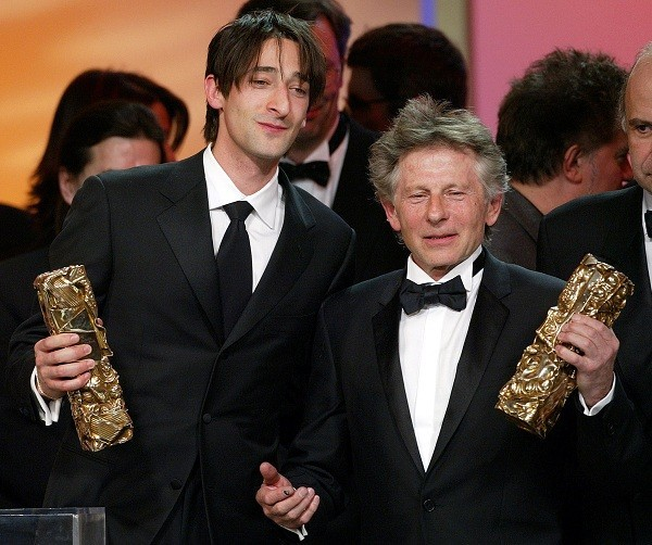 U.S actor Adrien Brody (L) and Polish director Roman Polanski (R) pose at the end of the French Cesars film award ceremony in Paris February 22, 2003.