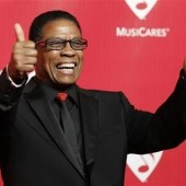 Musician Herbie Hancock poses at the 2012 MusiCares Person of the Year tribute honoring Paul McCartney in Los Angeles, February 10, 2012.